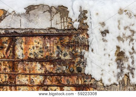 Background Old Cracked Wall Of A Building With A Metal Armature Covered With Ice