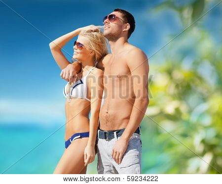 summer holidays and vacation concept - happy couple on the beach