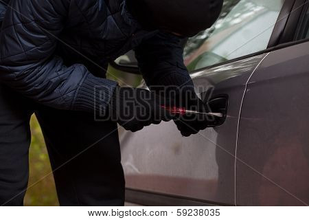 Man Breaking Into The Car