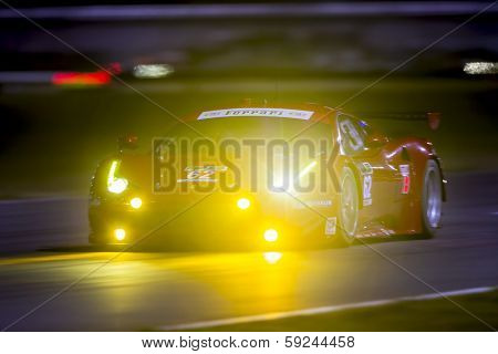 Daytona Beach, FL - Jan 23, 2014:  The Risa Competizione Ferrari goes through the turns during a practice session for the Rolex 24 at Daytona at Daytona International Speedway in Daytona Beach, FL.