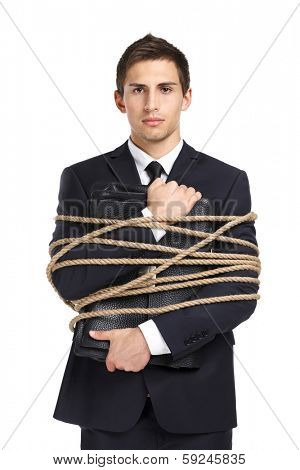 Portrait of businessman handing briefcase who tied with the rope, isolated on white. Concept of slavery and violence