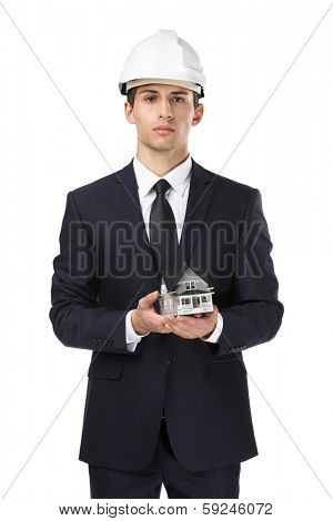 Businessman in white headpiece hands model house, isolated on white. Concept of real estate and engineering