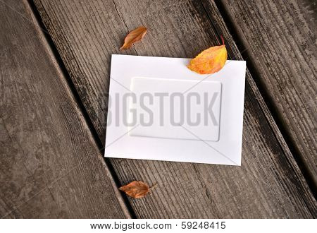 Paper photo frames in wood background