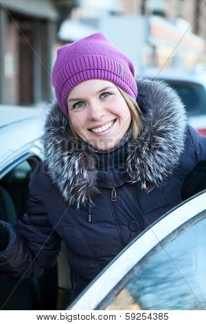 Happy Smiling Woman Get In The Car