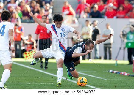 CARSON, CA. - FEB 01: USA M Brad Davis #11 & Korea M Min-Woo Kim #15 during the U.S. mens national team soccer friendly against Korea Republic on Feb 1st 2014 at the StubHub Center in Carson, Ca.