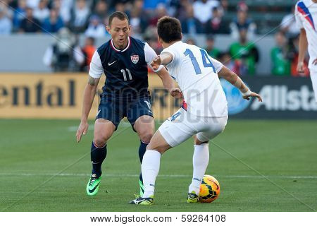 CARSON, CA. - FEB 01: Korea D Yong Lee #14 & USA M Brad Davis #11 during the U.S. mens national team soccer friendly against Korea Republic on Feb 1st 2014 at the StubHub Center in Carson, Ca.