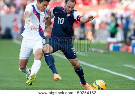 CARSON, CA. - FEB 01: Korea D Yong Lee #14 & USA M Landon Donovan #10 during the U.S. mens national team soccer friendly against Korea Republic on Feb 1st 2014 at the StubHub Center in Carson, Ca.