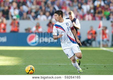 CARSON, CA. - FEB 01: Korea F Keun-Ho Lee #11 in action during the U.S. mens national team soccer friendly against Korea Republic on Feb 1st 2014 at the StubHub Center in Carson, Ca.