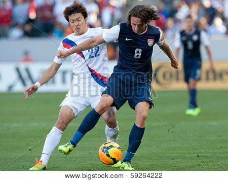 CARSON, CA. - FEB 01: USA M Mix Diskerud #8 & Korea M Jong-Woo Park #22 during the U.S. mens national team soccer friendly against Korea Republic on Feb 1st 2014 at the StubHub Center in Carson, Ca.