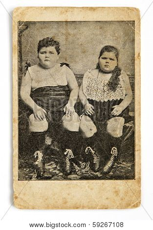 SAINT-PETERSBURG, RUSSIA - 1910: Antique photo shows boy and girl who are obese.