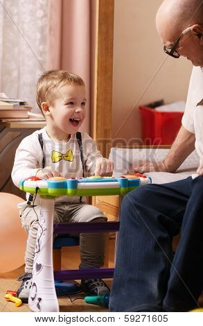 Candid portrait of a beautiful laughing toddler