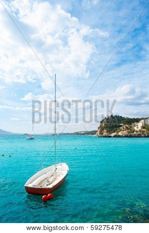 Altea Mediterranean sea detail with sailboat in alicante Spain