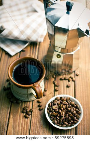 coffee with coffee beans and coffee maker on wooden table