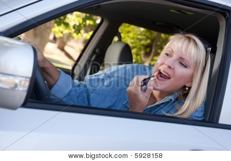 Woman Putting On Lipstick While Driving