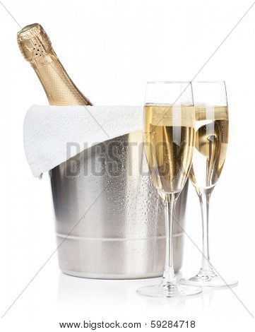 Champagne bottle in ice bucket and two glasses. Isolated on white background
