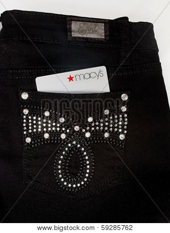 DAYTON, OHIO - FEBRUARY 2, 2014: Earl Jean jean pocket with Macys credit card.  Earl Jean is retailer of jeanwear based in Texas; Macys is USAs largest retail department store in regards to sales.