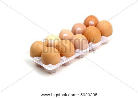 Dozen Of Brown Eggs In Plastic Package Isolated On White Background.