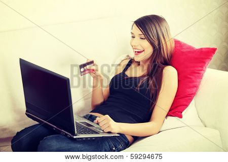 Young woman's sopping in internet. In home.