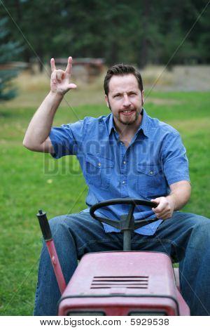 Man On Mower Rocking Out