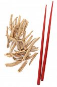 pic of ginseng  - Ginseng herb with red chopsticks over white background - JPG