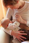 foto of breastfeeding  - Caucasian mother breastfeeding  her little baby - JPG