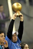 BARCELONA - JAN, 12: Supporter of Real Madrid holds up a imitation of golden ball trophy during a Sp