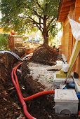 stock photo of sewage  - A utilities trench at the side of a newly build wood  - JPG