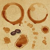 Vector coffee stain and grain on paper background.