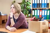 Thoughtful Woman With Collected In Box Things Sitting In Waiting