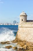 stock photo of el morro castle  - Detail of the castle of  El Morro with the skyline of Havana in the background - JPG
