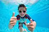 picture of swimming  - Portrait of a cute little boy swimming underwater - JPG