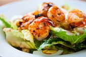 stock photo of grill  - Grilled shrimps and fresh green salad served for lunch - JPG