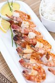 picture of tiger prawn  - Skewered Tiger Prawns with a portion of fresh Rice - JPG