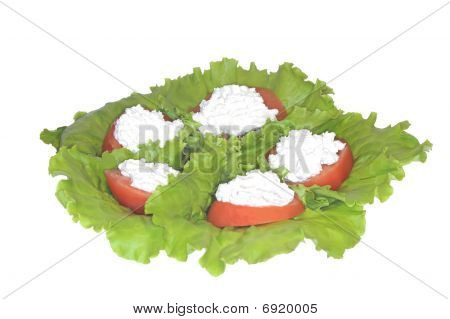 Tomatoes Stuffed Granular By Pot Cheese On Leaf Of The Green Salad