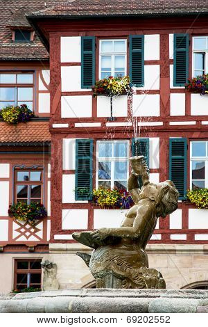 Fountain Statue Boy And Bavarian House In Schwabach