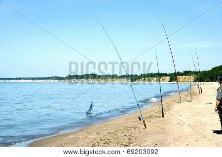 Latvia. Fishing From Coast Of Baltic Sea