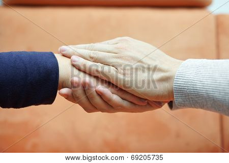 Man Hands Holding  Woman Hand From Both Sides. Compassion And .concern Concept