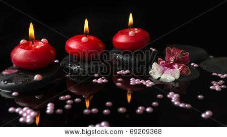 Spa Setting Of Red Candles, Orchid Cambria Flower On Zen Stones With Drops And Pearl Beads In Reflec