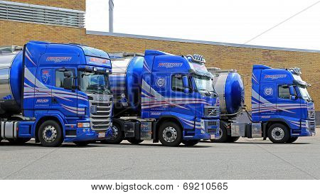 Fleet Of Blue Tanker Trucks On A Yard