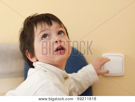 Child And A Light Switch
