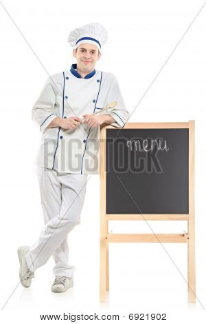 A chef posing near the board