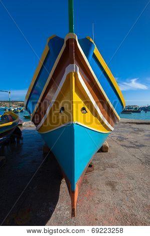 Traditional Maltese Colorful Boat In Marsaxlokk Village