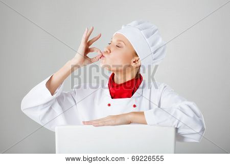 Woman Chef Cook Making Okay Gesture With His Hands After Tasteful Meal