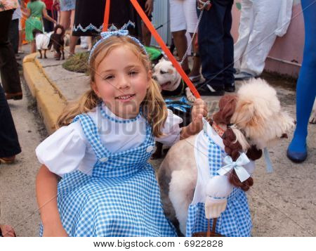 Little Girl with Costumed Dog