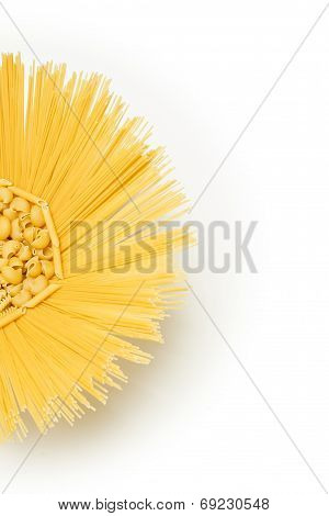 Pasta mix in a round recipient containing multiple types of pasta, top view isolated