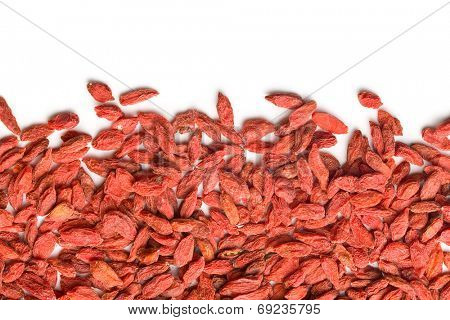 dried goji berries on white background