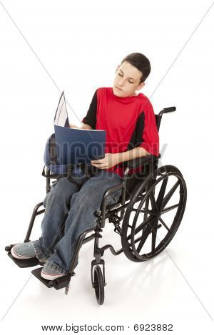 Teen Boy In Wheelchair Studying