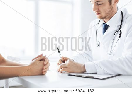close up of patient and doctor taking notes