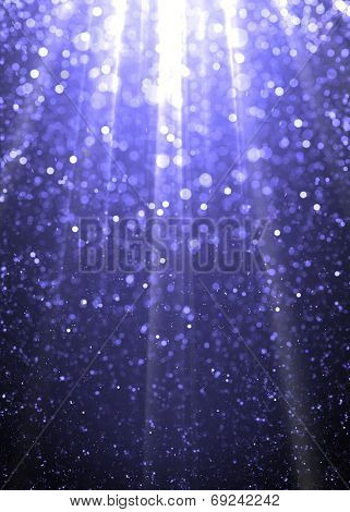 Blue sparkling underwater background. Defocused blue sparkle glitter lights background. Highlighted glitter bokeh background