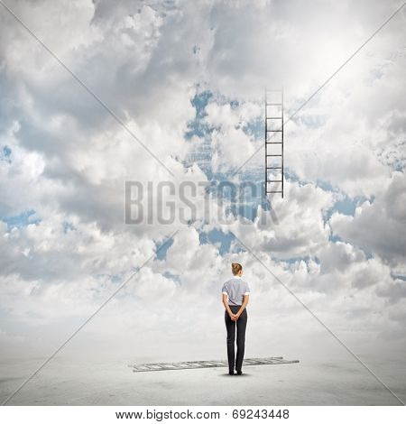 Rear view of businesswoman looking at broken ladder